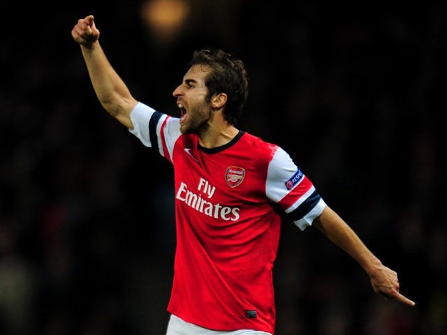 Mathieu Flamini of Arsenal reacts during the UEFA Champions League Group F match between Arsenal and Olympique de Marseille at Emirates Stadium on November 26, 2013