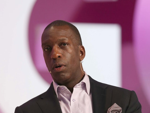 Retired US sprinter Michael Johnson speaks on the second day of the Doha Goals summit in the Qatari capital on December 11, 2013