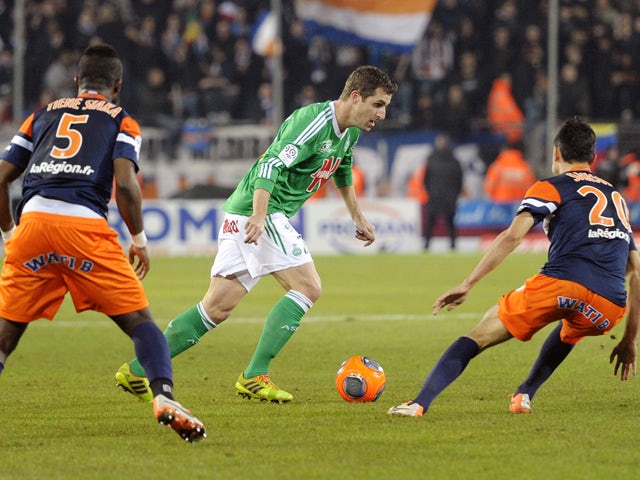 Saint-Etienne's French defender Francois Clerc vies for the ball with Montpellier's French mifielder Morgan Sanson and Montpellier's Ivoirian defender Siaka Tiene during the French L1 football match Montpellier vs Saint Etienne on December 13, 2013