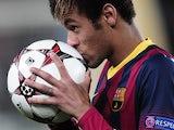 Barcelona's Brazilian forward Neymar da Silva Santos Junior kisses a ball after scoring a hat-trick during the UEFA Champions League Group H football match against Celtic on December 11, 2013