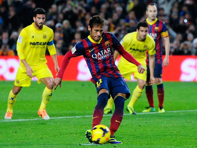 Neymar of FC Barcelona scores the opening goal from the penalty spot during the La Liga match between FC Barcelona and Villarreal CF at Camp Nou on December 14, 2013