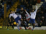 Clive Platt of Northampton Town contests the ball with Tommy Miller and Nathan Cameron of Bury during the Sky Bet League Two match on December 14, 2013