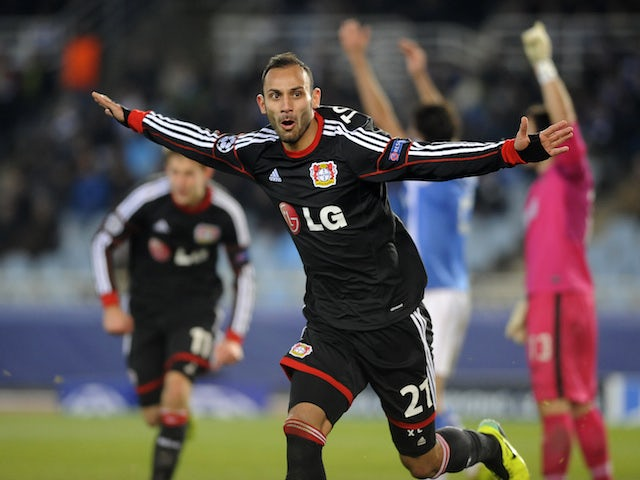 Leverkusen's Turkish defender Oemer Toprak celebrates after scoring his team's first goal during the UEFA Champions League Group A football match against Real Sociedad de Futbol on December 10, 2013