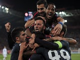 Olympiakos' players celebrate after scoring a goal during the UEFA Champions League group C football match between Olympiakos and Anderlecht at the Karaiskaki stadium in Athens on December 10, 2013