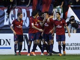 Osasuna's players celebrate a goal during the Spanish league football match Osasuna vs Real Madrid at the Reyno de Navarra in Pamplona on December 14, 2013