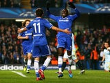 Oscar and Demba Ba of Chelsea celebrate after Danijel Georgijevski of Steaua scores an own goal to open the scoring during the UEFA Champions League Group E match on December 11, 2013