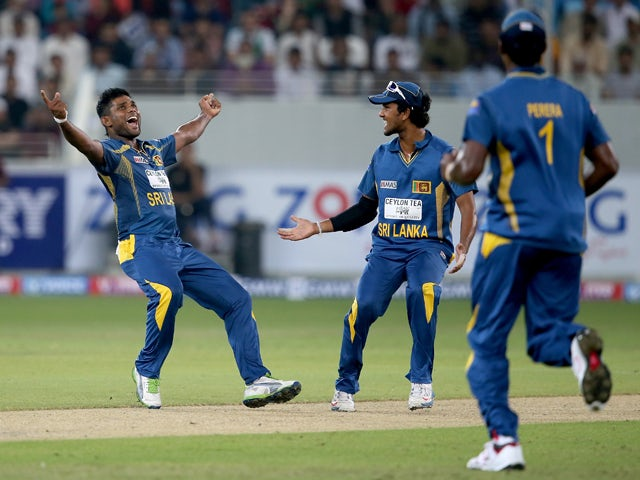Seekuge Prasanna of Sri Lanka celebrates after dismissing Sharjeel Khan of Pakistan during the second Twenty20 International match between Pakistan and Sri Lanka at Dubai Sports City Cricket Stadium on December 13, 2013
