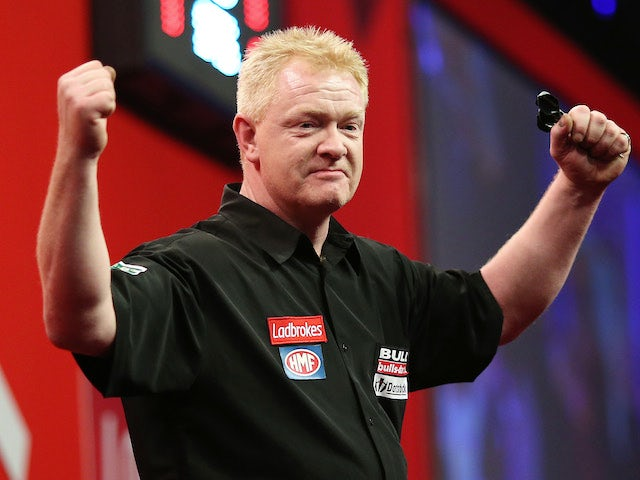 Per Laursen of Denmark celebrates after he wins his first round match against Terry Jenkins of England during the Ladbrokes.com World Darts Championship on December 14, 2013