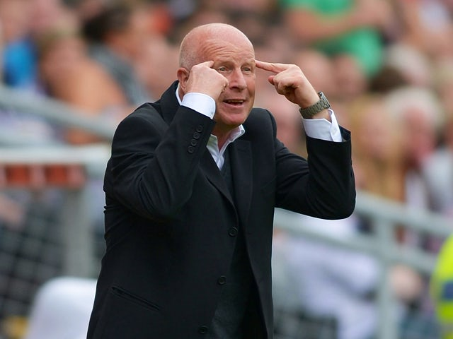 Dundee United manager Peter Houston passing instructions to his players during the Scottish Premier League match between Dundee United and Dundee at Tannadice Park on August 19, 2012