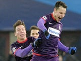 Austria Wien forward Philipp Hosiner celebrates with Marko Stankovic after scoring during the UEFA Champions League group G football match against Zenit on December 11, 2013