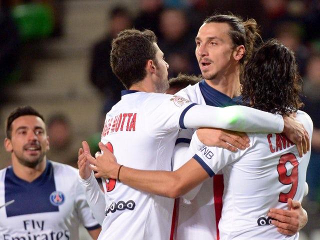 Paris Saint-Germain's Swedish forward Zlatan Ibrahimovic jubilates with teammates after scoring during the French L1 football match Rennes against Paris Saint Germain on December 14, 2013