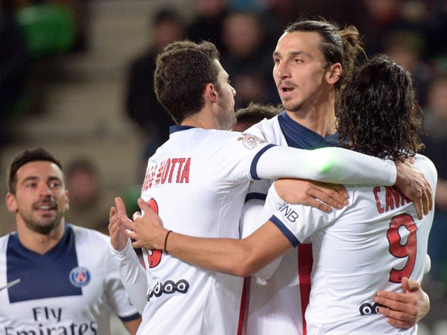 Paris Saint-Germain's Swedish forward Zlatan Ibrahimovic jubilates with teammates after scoring during the French L1 football match Rennes against Paris Saint Germain on December 14, 2013