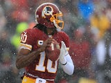 Quarterback Robert Griffin III of the Washington Redskins drops back to pass against the Kansas City Chiefs during the first quarter at FedExField on December 8, 2013