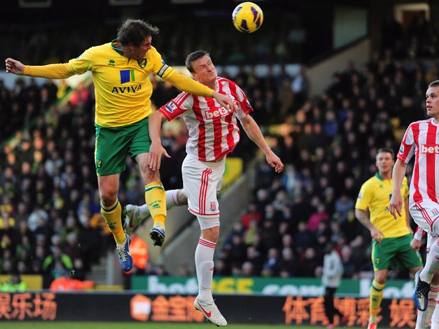 Robert Huth of Stoke City battles with Grant Holt of Norwich City during the Barclays Premier League match between Norwich City and Stoke at Carrow Road on November 3, 2012