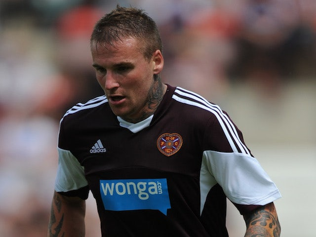 Ryan Stevenson of Hearts in action during a pre season friendly match between Dunfermline Athletic and Hearts at East End Park on July 13, 2013