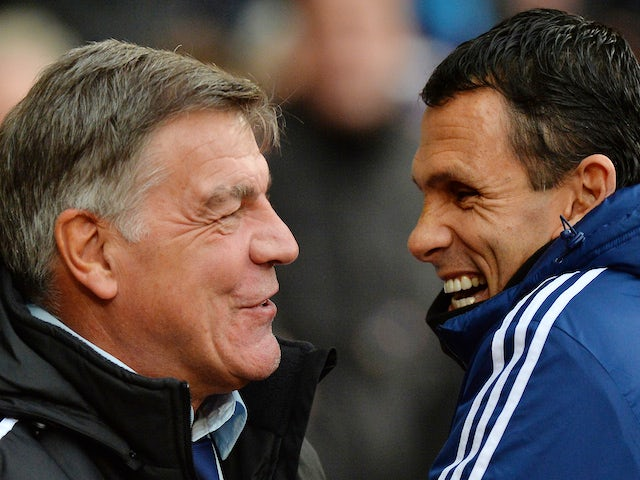 West Ham United's English manager Sam Allardyce (L) smiles as he welcomes Sunderland's Uruguayan manager Gus Poyet (R) ahead of the English Premier League football match on December 14, 2013