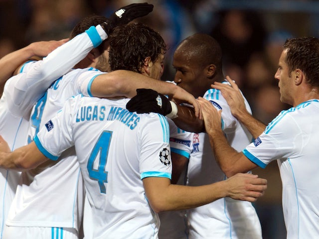 Marseille's Senegalese defender Souleymane Diawara celebrates with team mates after scoring a goal during an UEFA Champions League group F football match against Dortmund on December 11, 2013