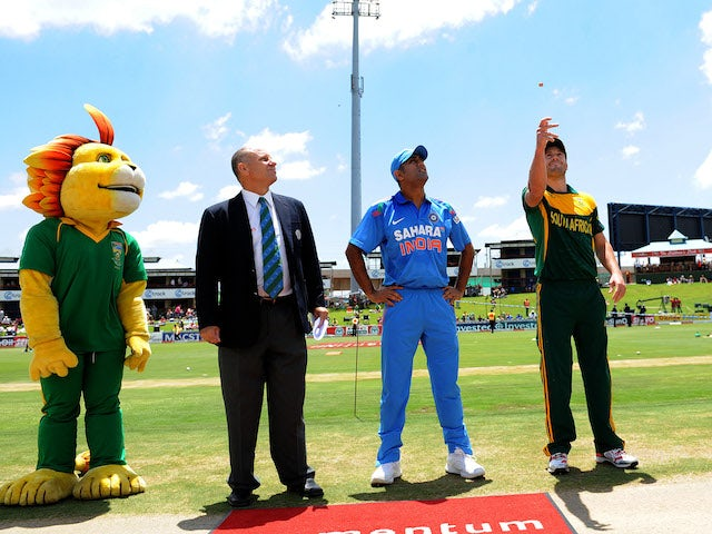 AB de Villiers of South Africa and MS Dhoni of India at the toss during the 3rd Momentum ODI match between South Africa and India at SuperSport Park on December 11, 2013