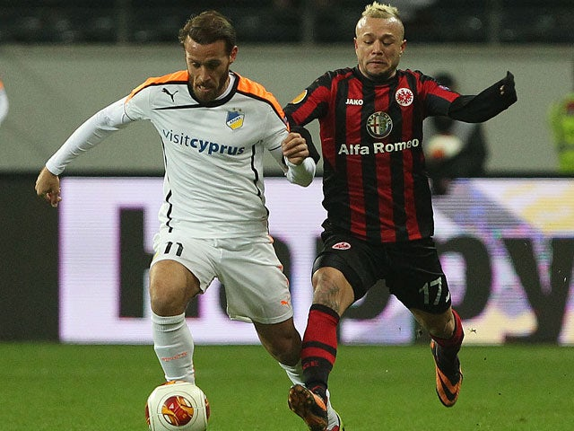 Frankfurt's Stephan Schroeck and Apoel's Nektarios Alexandrou in action during their Europa League group match on December 12, 2013