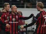 Frankfurt's Stephan Schroeck celebrates with teammates after scoring the opening goal against APOEL during their Europa League group match on December 12, 2013