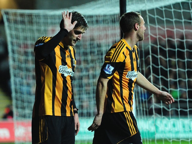 Hull striker and former Swansea player Danny Graham apologises to the Swansea fans after opening the scoring during the Barclays Premier league match between Swansea City and Hull City at the Liberty Stadium on December 9, 2013