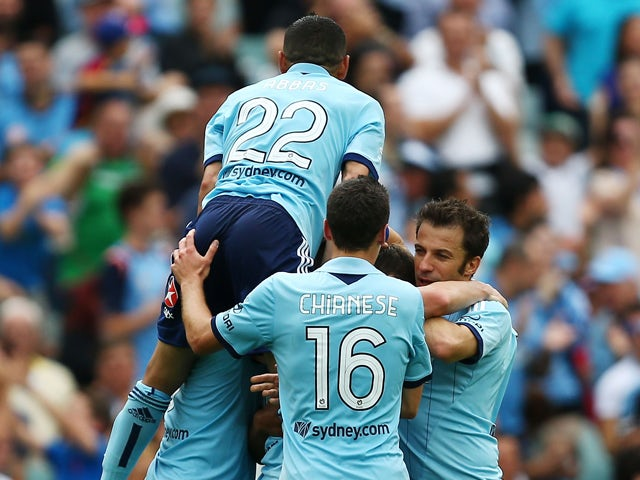 Ranko Despotovic of Sydney FC is swamped by team mates after scoring the second goal during the round 10 A-League match between Sydney FC and the Melbourne Heart at Allianz Stadium on December 15, 2013