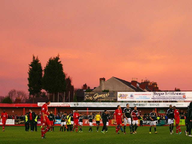 The players of Tamworth and Bristol City head to the dressing room at full time during the FA Cup Second Round match between Tamworth and Bristol City on December 8, 2012