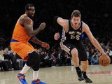 Tiago Splitter #22 of the San Antonio Spurs drives past Amar'e Stoudemire #1 of the New York Knicks during the second half at Madison Square Garden on November 10, 2013