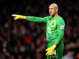 Tim Howard of Everton points during the Barclays Premier League match between Arsenal and Everton at Emirates Stadium on December 8, 2013