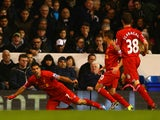 Captain Luis Suarez of Liverpool celebrates scoring the opening goal during the Barclays Premier League match between Tottenham Hotspur and Liverpool at White Hart Lane on December 15, 2013