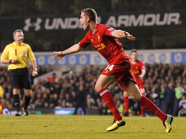 Liverpool's English midfielder Jordan Henderson celebrates scoring a goal during the English Premier League football match between Tottenham Hotspur and Liverpool at White Hart Lane in London, England, on December 15, 2013