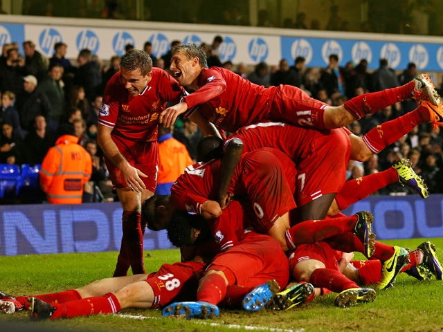 Jon Flanagan of Liverpool is mobbed by his team mates after scoring their third goal during the Barclays Premier League match between Tottenham Hotspur and Liverpool at White Hart Lane on December 15, 2013