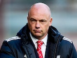 Brentford manager Uwe Rosler looks on ahead of the Sky Bet League One match between Brentford and Crewe Alexandra at Griffin Park on November 16, 2013