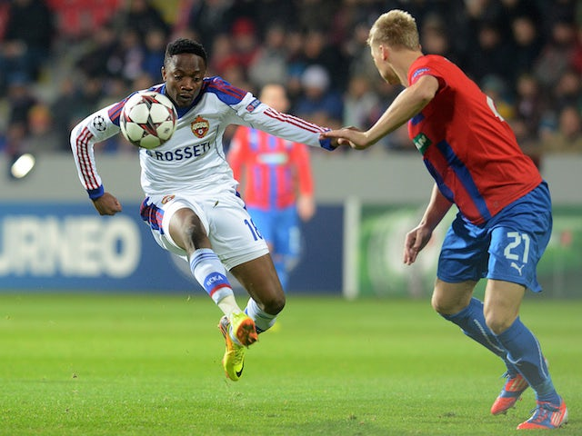 Plzen's Vaclav Prochazka and CSKA Moscow's striker Ahmed Musa (L) vie for the ball during the UEFA Champions League group D match Viktoria Plzen vs CSKA Moscow on December 10, 2013