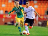 Kuban's Vladislav Ignatyev and Valencia's Jose Gaya in action during their Europa League group match on December 12, 2013