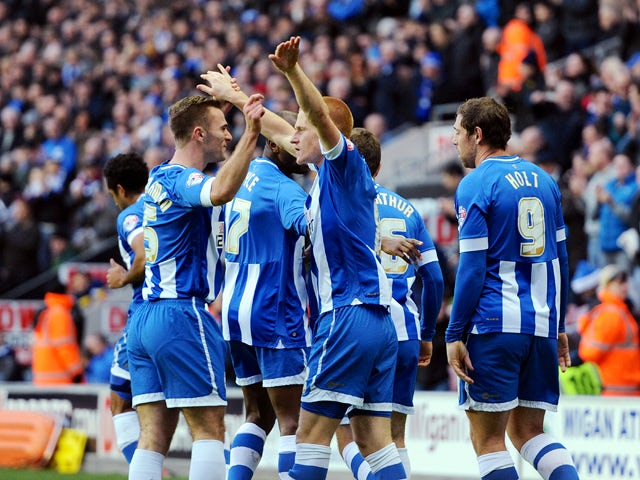 Ben Watson of Wigan Athletic celebrates with team-mate Callum Mcmanaman after he scores the first goal of the game for his side from the penalty spot during the Sky Bet Championship match between Wigan Athletic and Bolton Wanderers at the DW Stadium on De