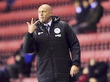 Manager Uwe Rosler of Wigan Athletic gestures during the Sky Bet Championship match between Wigan Athletic and Bolton Wanderers at the DW Stadium on December 15, 2013