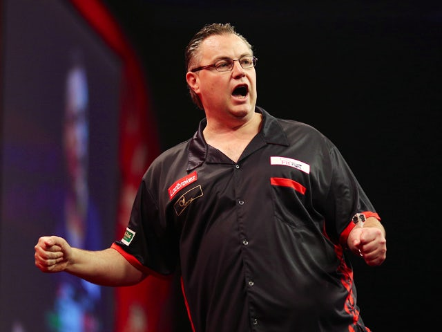 John Part of Canada celebrates winning a leg during his first round match against Mareno Michels of The Netherlands during the Ladbrokes.com World Darts Championship on Day One at Alexandra Palace on December 13, 2013