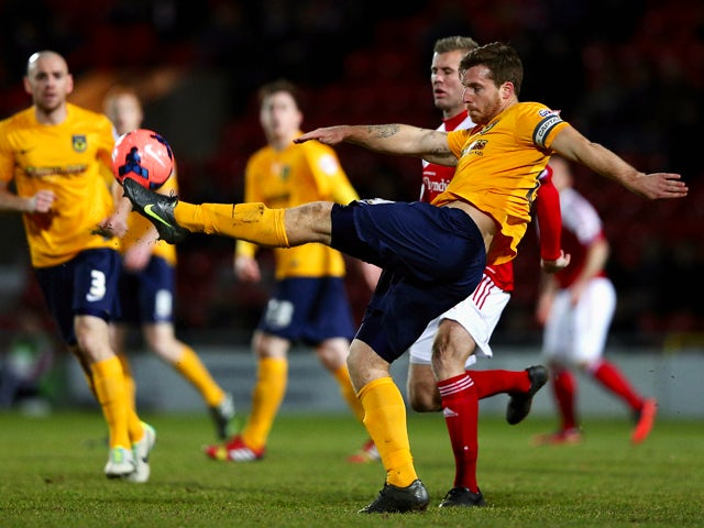 Johnny Mullins of Oxford United clears the ball during the FA Cup Second Round match between Wrexham AFC and Oxford United at Racecourse Ground on December 9, 2013