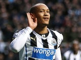 Newcastle United's French striker Yoan Gouffran celebrates scoring the opening goal during the English Premier League football match between Newcastle United and Southampton at St James' Park on December 14, 2013