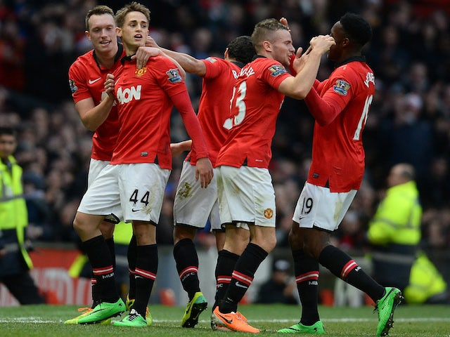 Manchester United's Belgium midfielder Adnan Januzaj celebreates with team-mates after a goal against West Hamon December 21, 2013