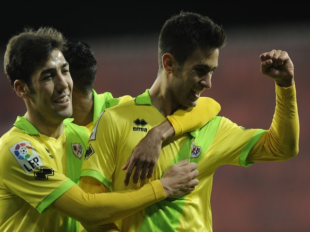Rayo Vallecano's forward Alberto Bueno celebrates a goal with teammate Alberto Perea during the Spanish league football match against Athletic Bilbao on December 22, 2013