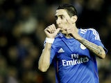 Real Madrid's Argentinian midfielder Angel di Maria celebrates his goal during the Spanish league football match Valencia vs Real Madrid at the Mestalla stadium in Valencia on December 22, 2013
