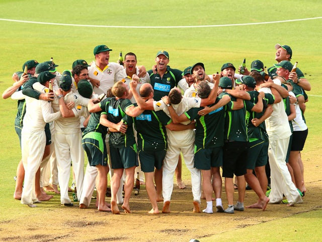 Nathan Lyon of Australia leads the team song on the pitch after day five of the Third Ashes Test Match between Australia and England at WACA on December 17, 2013