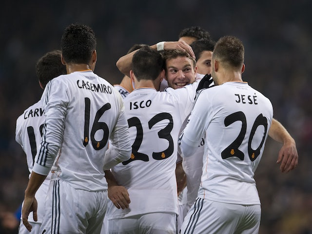 Real Madrid's midfielder Asier Illarramendi (2ndR) celebrates with teammates after scoring during the Spanish Copa del Rey (King's Cup) finals stage second-leg football match against Olimpic on December 18, 2013