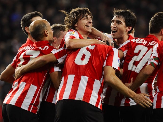 Athletic Bilbao's players celebrate a goal during the Spanish league football match Athletic Bilbao vs Rayo Vallecano at the San Mames stadium in Bilbao on December 22, 2013