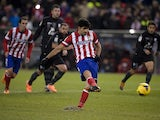 Atletico Madrid's Brazilian forward Diego da Silva Costa scores on a penalty kick during the Spanish league football match Club Atletico de Madrid vs Levante UD at the Vicente Calderon stadium in Madrid on December 21, 2013
