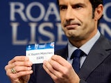 UEFA Champions League Final Ambassador, former Portuguese international footballer Luis Figo holds up the name of German club Bayern Munich during the draw for the last 16 of the UEFA Champions league tournament at the UEFA headquarters in Nyon on Decembe