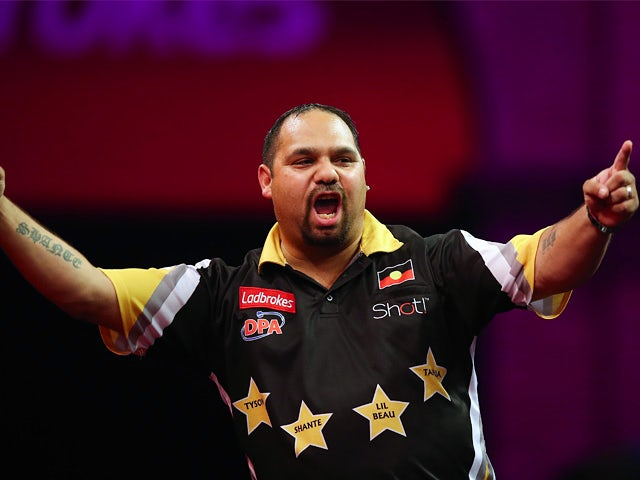 Beau Anderson reacts during his first round match against Colin Lloyd during the World Darts Championship on December 17, 2013