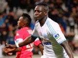 Marseille's French defender Benjamin Mendy celebrates after scoring a goal during the French League Cup round of sixteen football match Marseille vs Toulouse on December 18, 2013